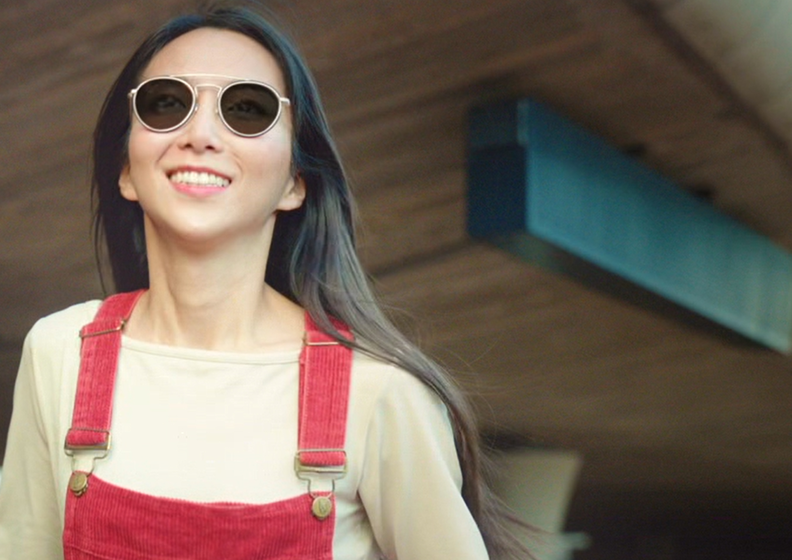 Young asian woman wearing glasses with Transition lenses