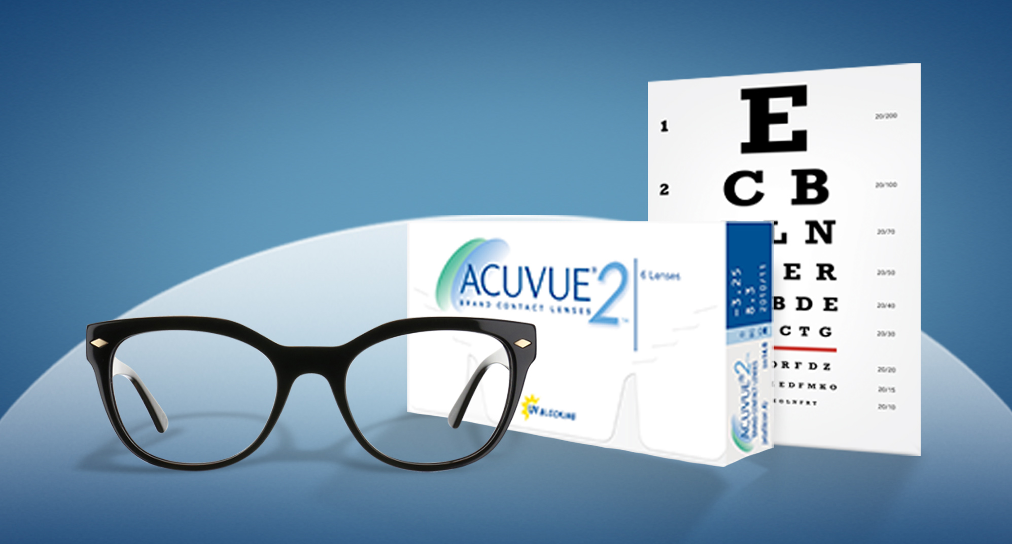 Pair of glasses, Box of contact lenses & Snellen eye chart